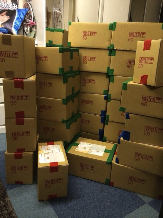 akb48 bulk buy cds albums mass votes election senbatsu labrador retriever otaku fans