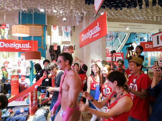 desigual seminaked party bikini swimsuit swimwear event harajuku tokyo store naked customers flash mob