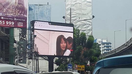jakarta indonesia rush hour japanese porn av hacked billboard display screen advertising plays sex