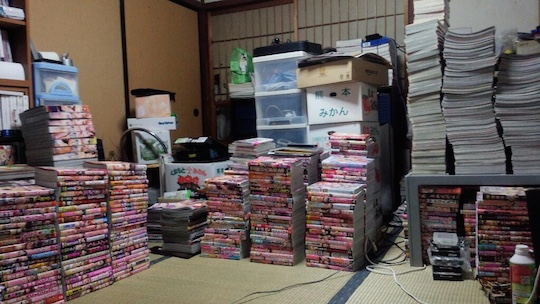 japan crushed death pile stack porn magazines